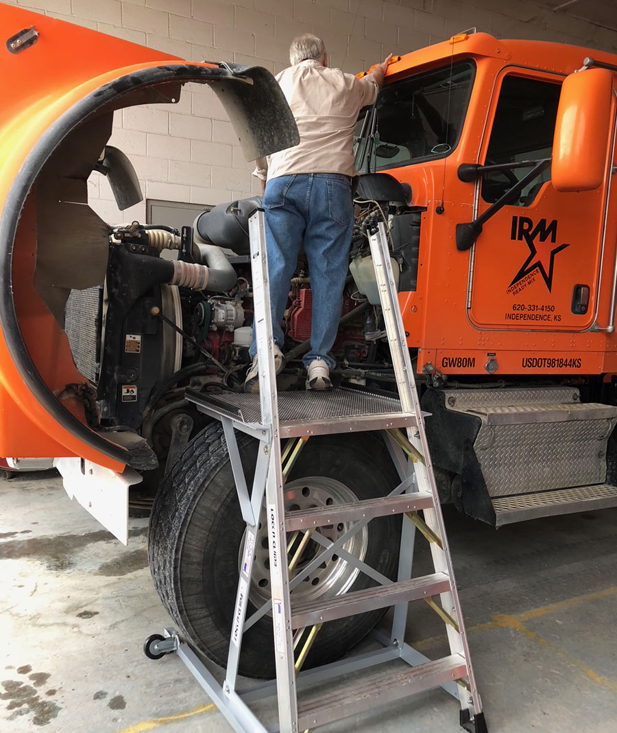 MRO Truck Ladder with technician working on Concrete truck