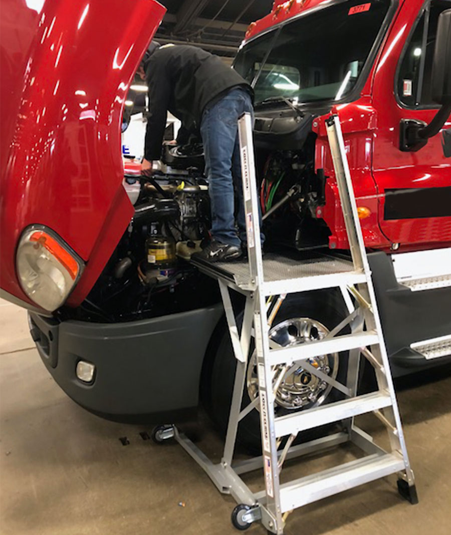 MRO Truck Ladder with technician working on truck engine