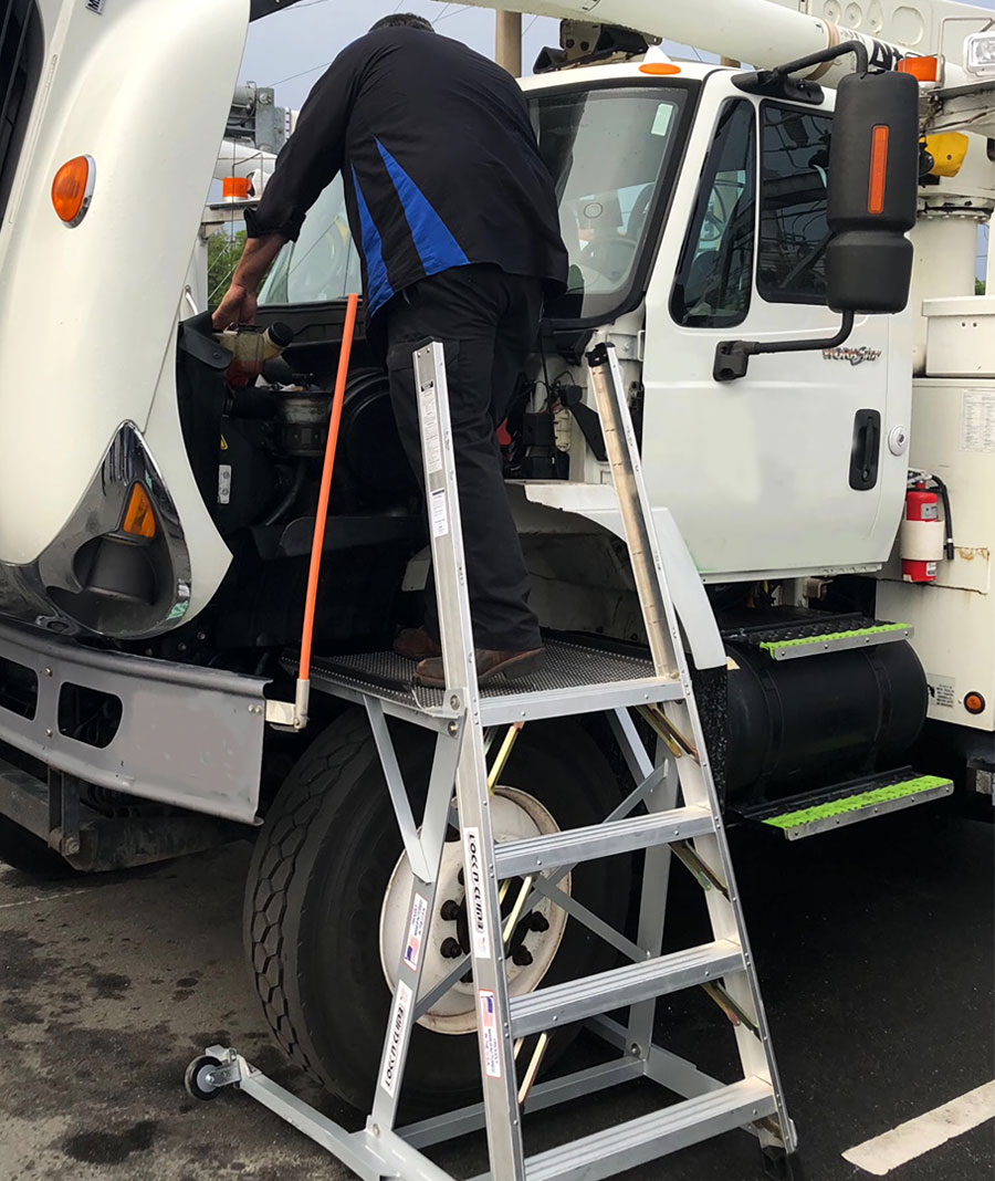 MRO Truck Ladder with technician working on utility truck