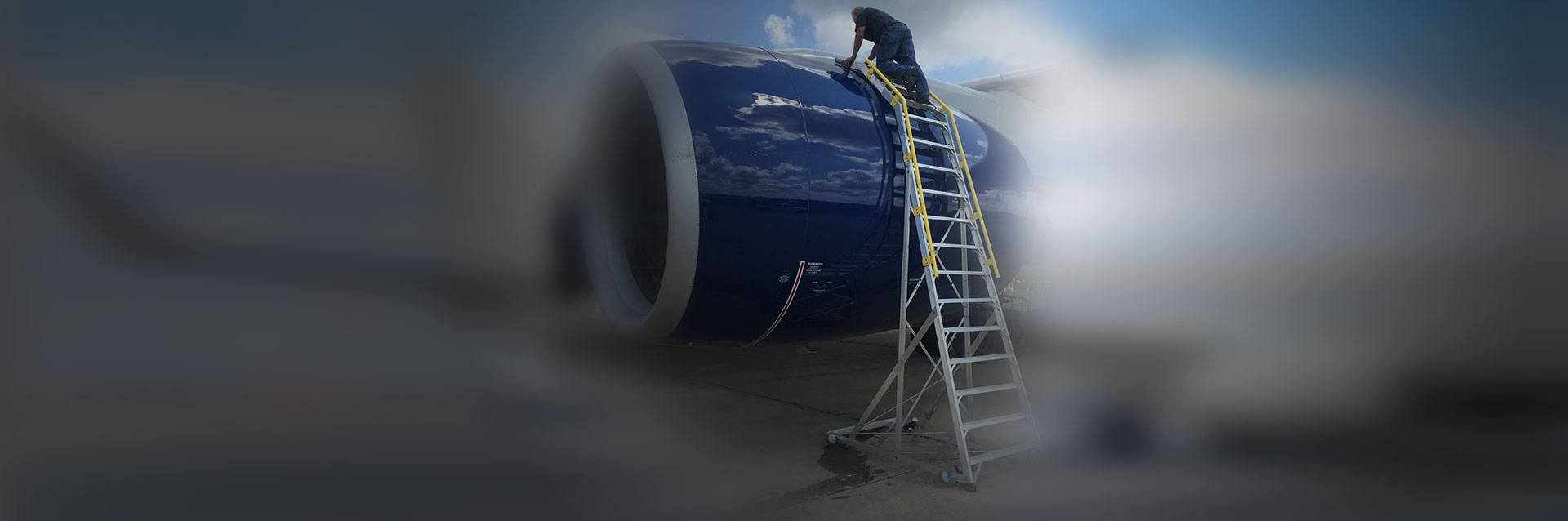 18 Foot Cowl Pylon With Technician Working On Boeing 777 Engine On Tarmac Hero Shot